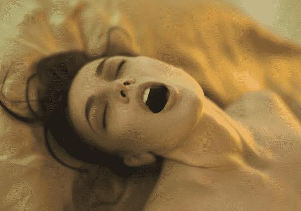 a woman enjoying tantric massage therapy
