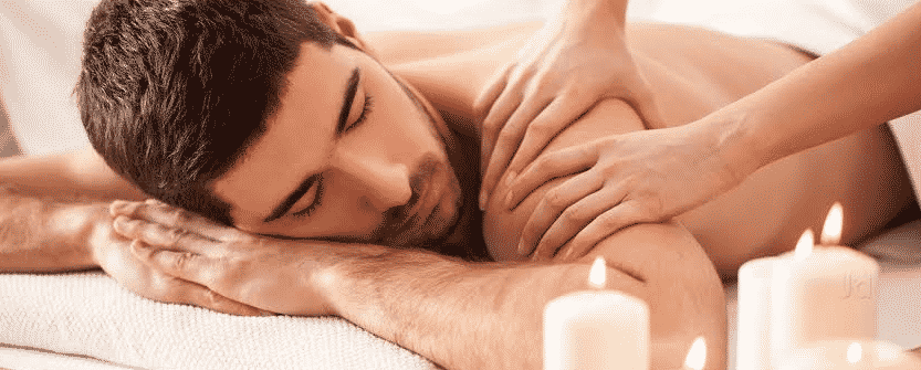 an image of a man enjoying sensual massage